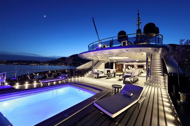 Mega yacht OKTO - Main deck aft pool and sun loungers