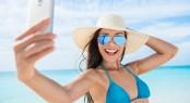 Selfie smartphone girl taking mobile phone photo on beach vacati