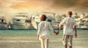 Couple on the sea beach under sunlight