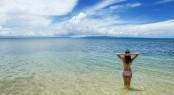 Young Woman In Bikini Standing In Clear Water On Taveuni Island,
