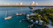 Aerial view of exotic island with authentic buildings and pier f