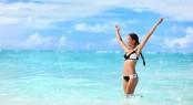 Happy bikini woman having fun swimming in ocean. Freedom bikini