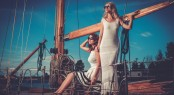 Stylish wealthy women on a luxury yacht.