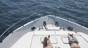 Young couple sunbathing on luxury yacht