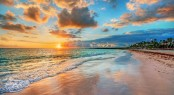 Bright and dynamic sea beach sunrise with bright blue skies and
