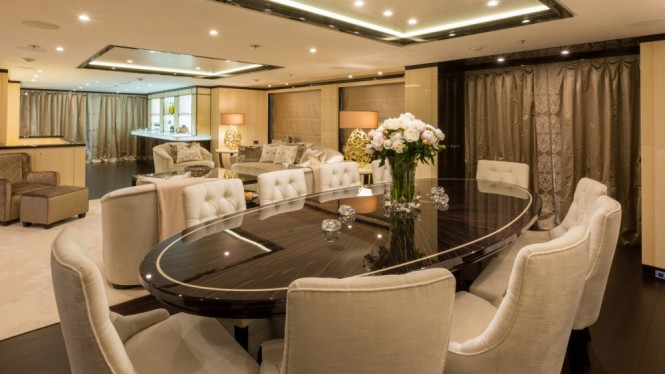 Luxury yacht ELIXIR - Main salon and formal dining area with Makassar wood furnishings
