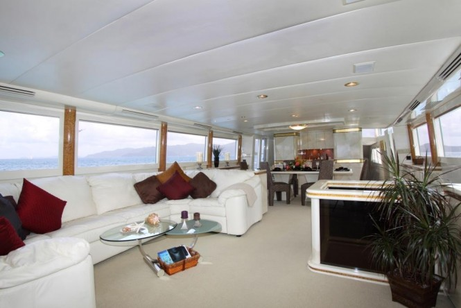 Salon and formal dining area aboard superyacht INSATIABLE