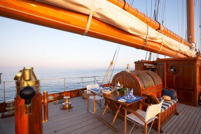Aft deck alfresco dining aboard superyacht GERMANIA NOVA