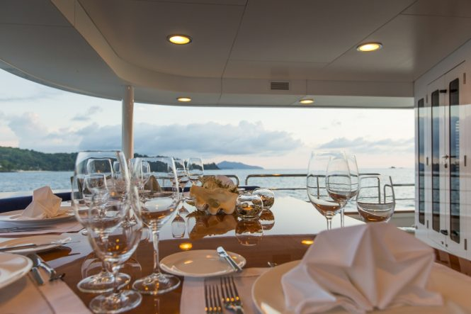 Alfresco dining on the main deck aft of luxury yacht NORTHERN SUN