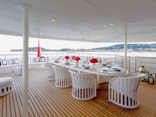 Alfresco dining on the upper deck of luxury yacht MISCHIEF