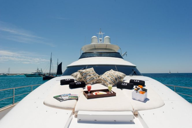 Bow sunbathing aboard luxury yacht LEX