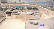 Flybridge sunpads and alfresco dining aboard luxury yacht AMOR