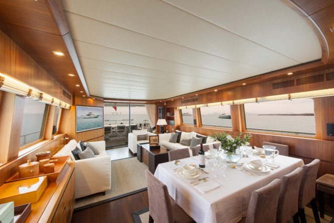 Formal dining area and salon interior aboard M/Y LEX