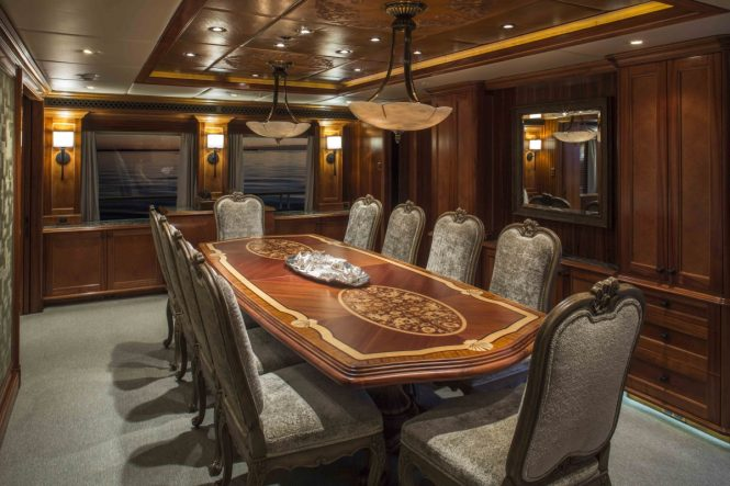 Formal dining room aboard luxury yacht UNBRIDLED
