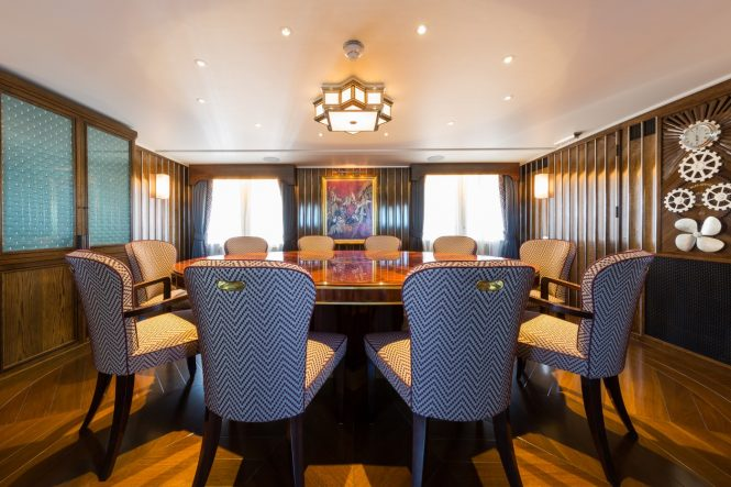 Formal dining room aboard motor yacht MALAHNE. Photo credit: Jeff Brown