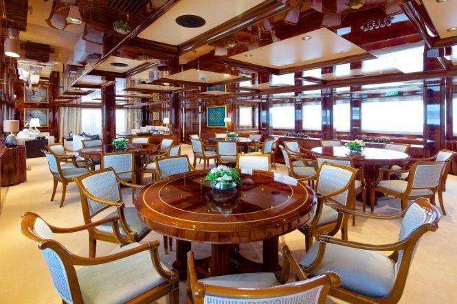 Formal dining room aboard motor yacht O'MEGA