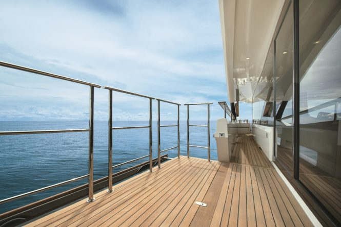Luxury yacht MCY 96 - Fold down balcony on the main deck. Photo credit Monte Carlo Yachts