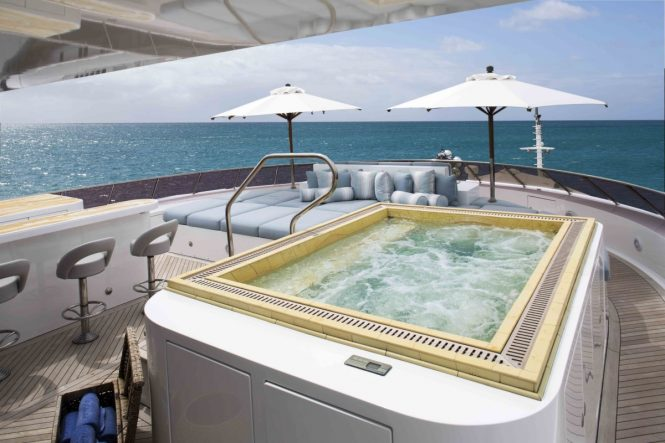 Luxury yacht UNBRIDLED - Sundeck Jacuzzi, sunpads and bar