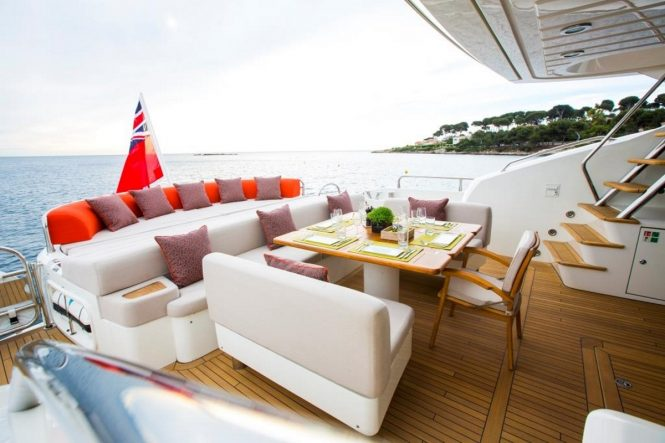 M/Y FIRECRACKER - Main deck aft alfresco dining and sunpads