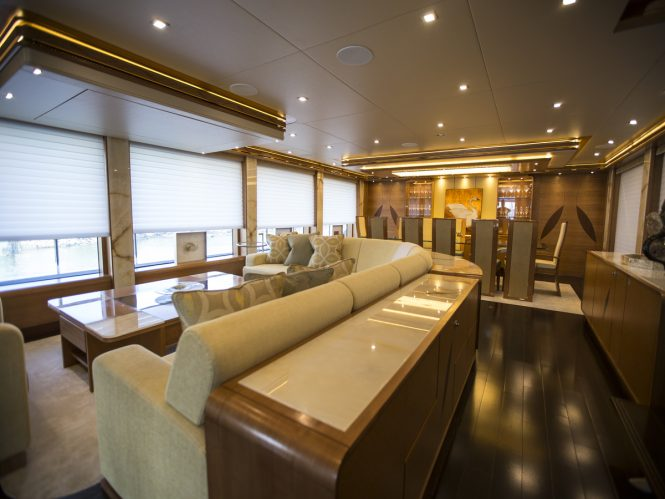 Main salon and formal dining area aboard luxury yacht SERENITY