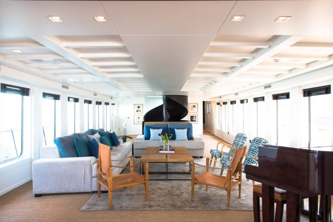 Main salon with grand piano aboard motor yacht MENORCA. Photo credit Mare e Terra