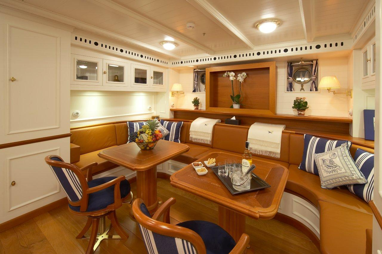 Salon adjecent to the formal dining area aboard luxury yacht GERMANIA NOVA