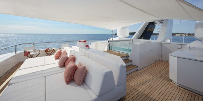 Shaded sundeck sunpads and Jacuzzi aboard M/Y JOY