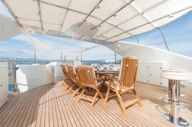 Sundeck alfresco dining abaord motor yacht BLUE VISION
