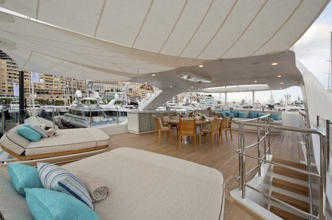 Sundeck sunpads and alfresco dining aboard motor yacht SCORPION