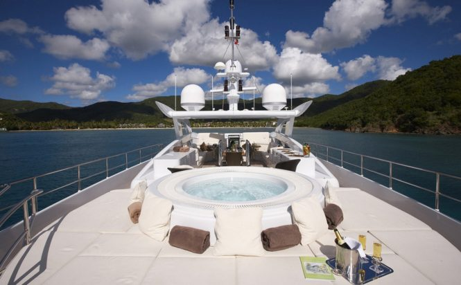 Sunpads and Jacuzzi on the upper deck of luxury yacht DESTINY