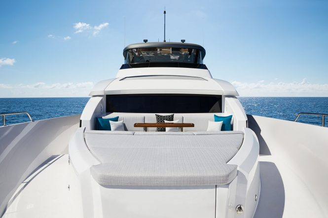 Sunpads and seating on the bow of motor yacht M90 from Hatteras
