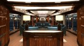 The open plan main salon and formal dining area aboard Conrad superyacht C133
