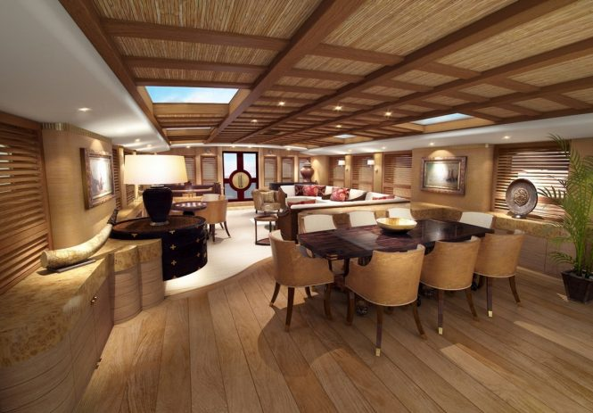 The open-plan salon and formal dining area aboard luxury ketch ZANZIBA