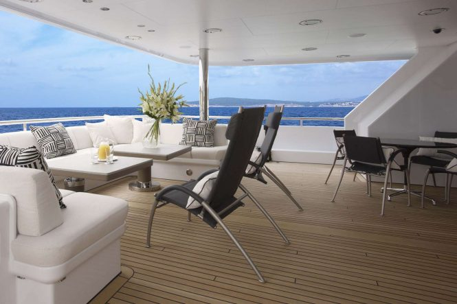Main deck aft seating aboard motor yacht HURRICANE RUN. Photo credit: Feadship