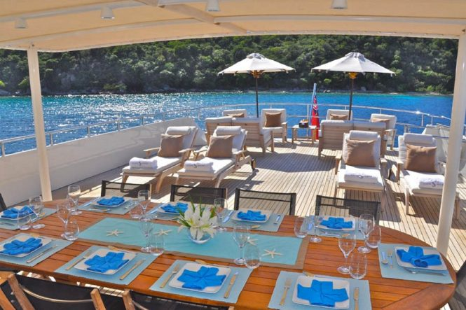 Superyacht LIONSHARE - Alfresco dining and outdoor saloon on the upper deck aft