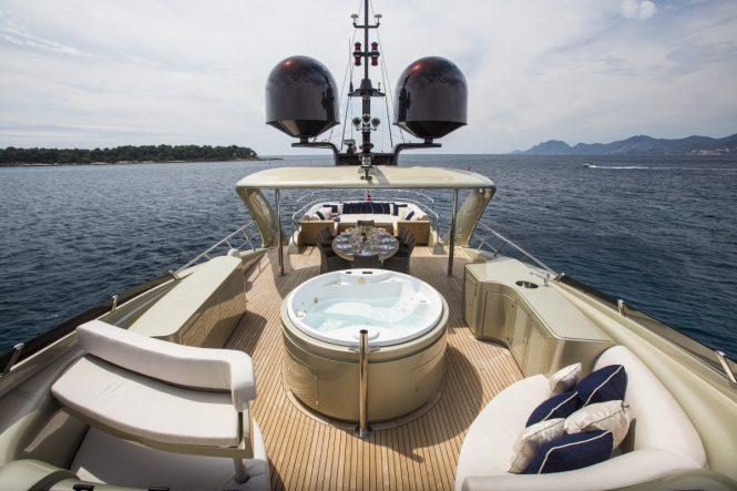 The Jacuzzi, sunpads and alfresco dining area aboard superyacht MIDNIGHT SUN
