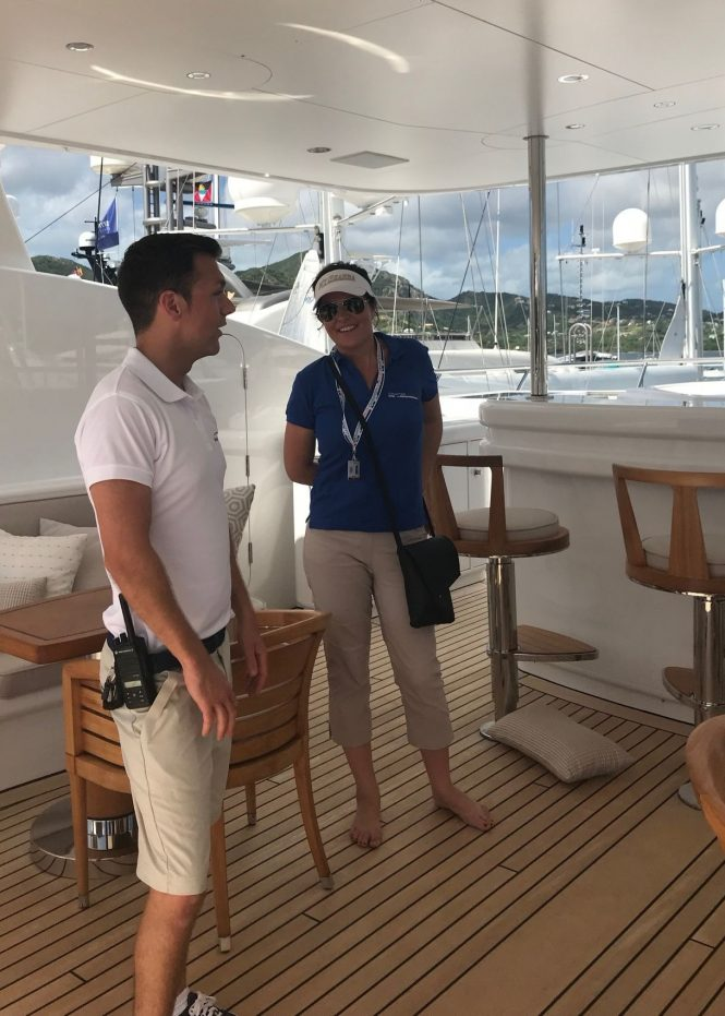 Charter Broker Trina Howes aboard a superyacht with a crew member at the Antigua Yacht Show 2017