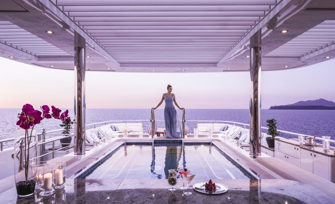 Pool deck aboard TITANIA at sunset