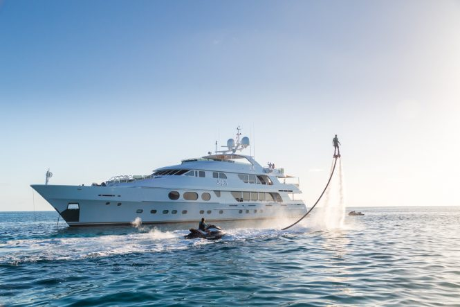 Motor Yacht LADY JOY by Christensen - Anchored with water toys
