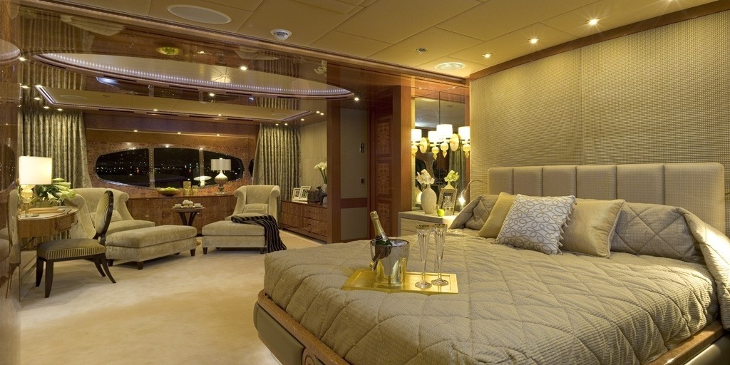 Master suite with large bed and lounge area