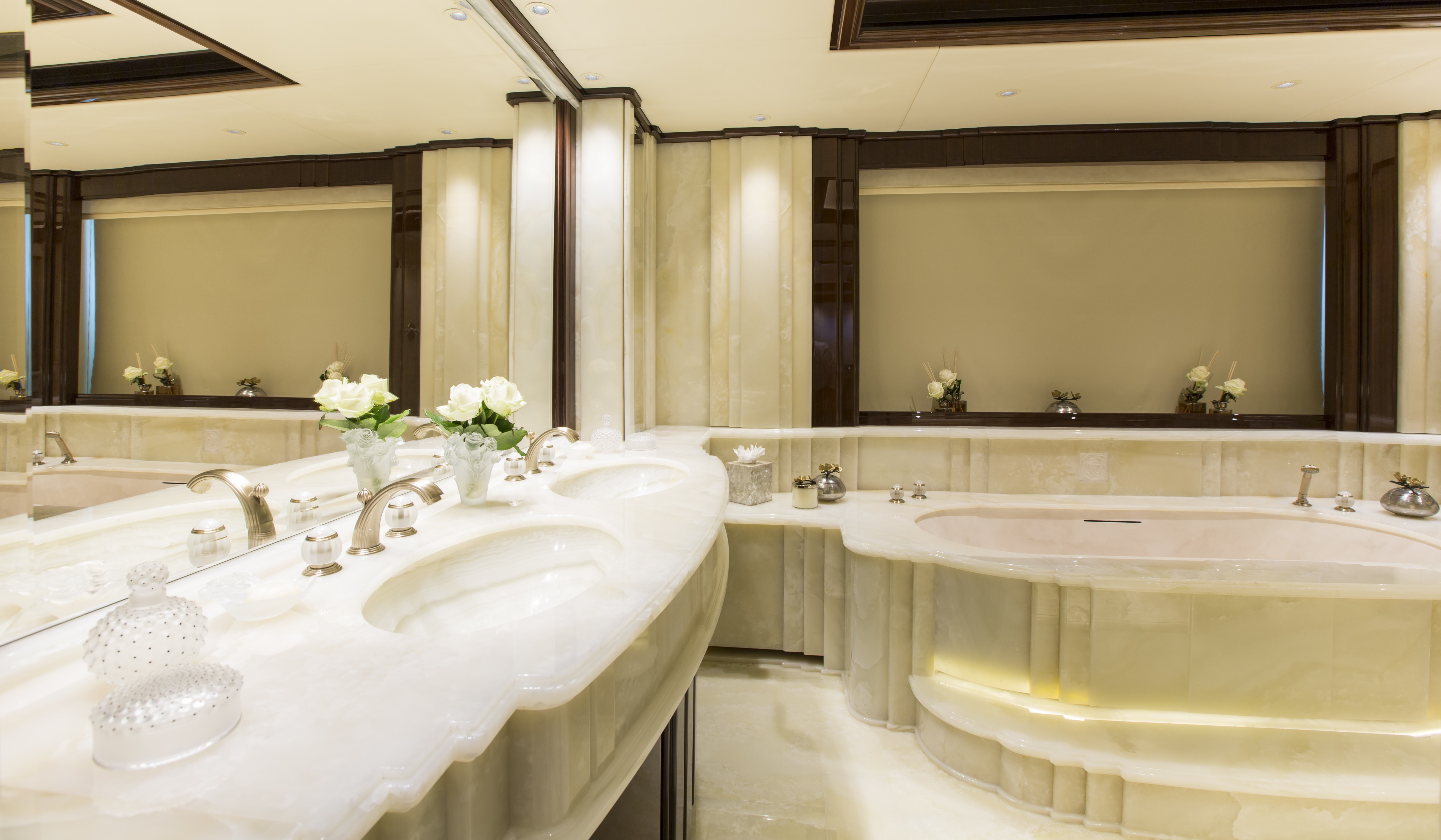 marble guest bathroom with a huge bath