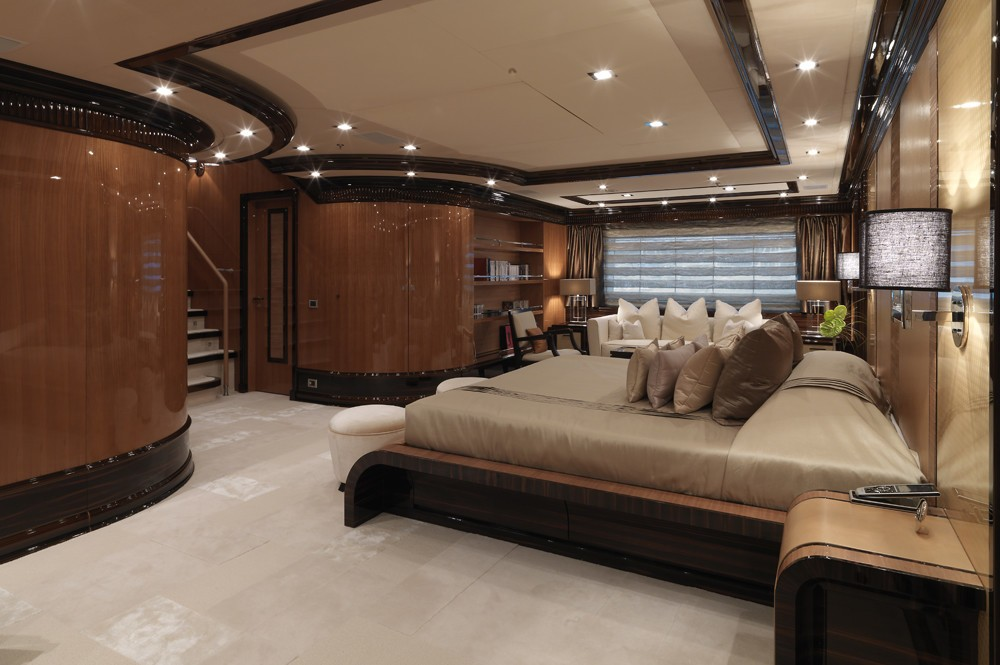 huge master suite with plush furnishings and custom-made furniture