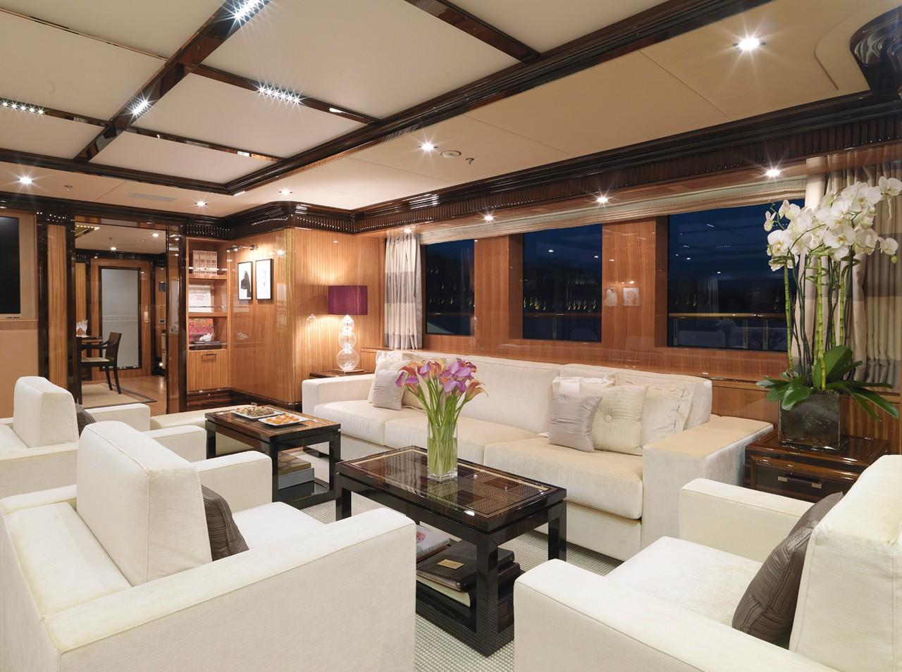 main deck saloon seating area with large couches at night