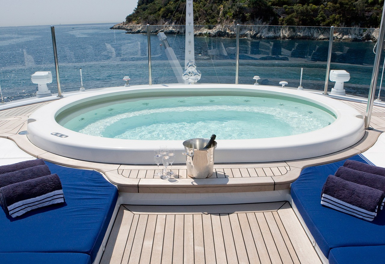 Large Jacuzzi pool with Champagne and sun pads to relax on