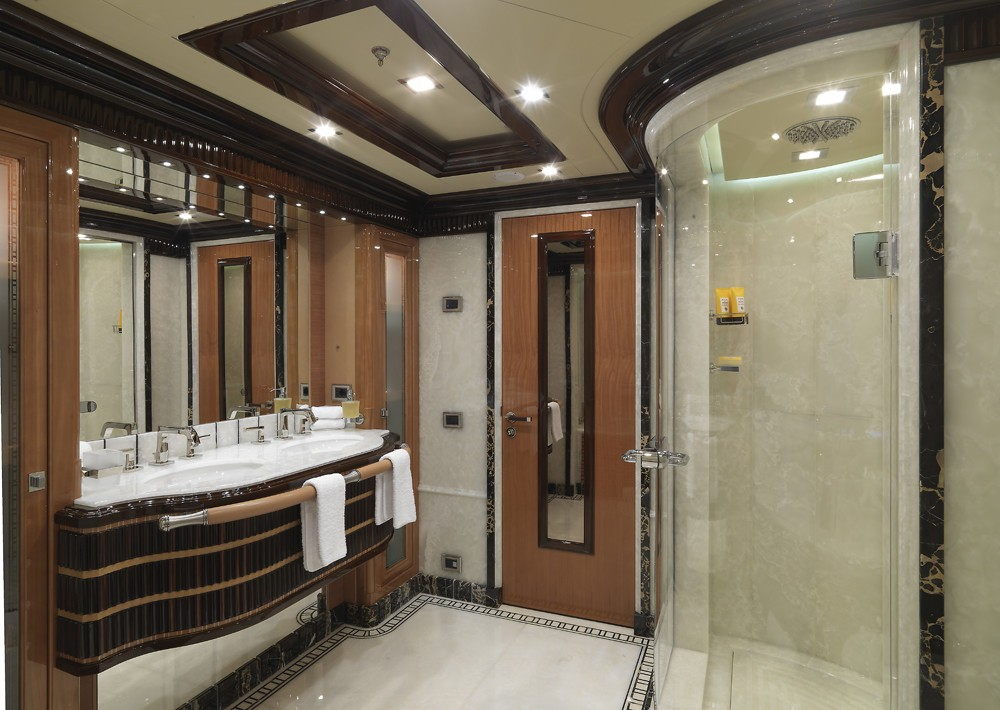 main master suite ensuite bathroom with large shower and luxurious marble details