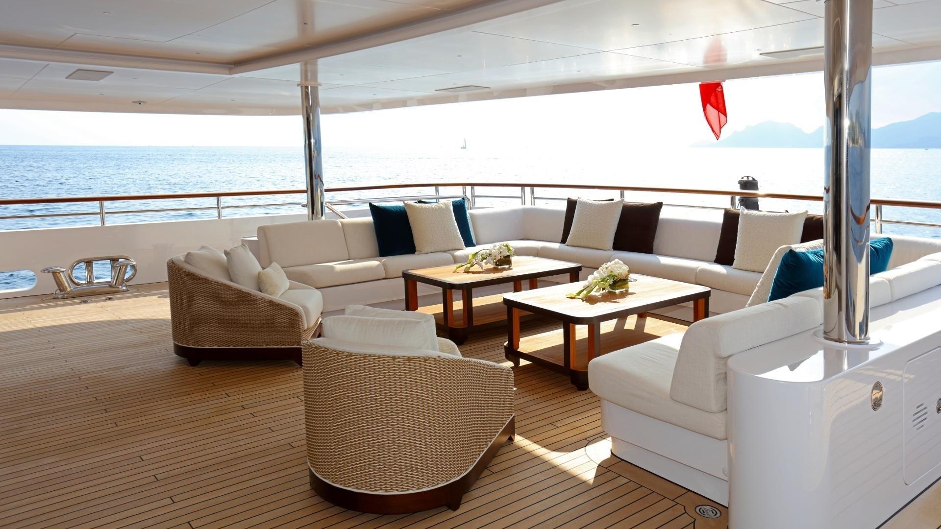 main deck aft u-shaped sofa and coffee tables