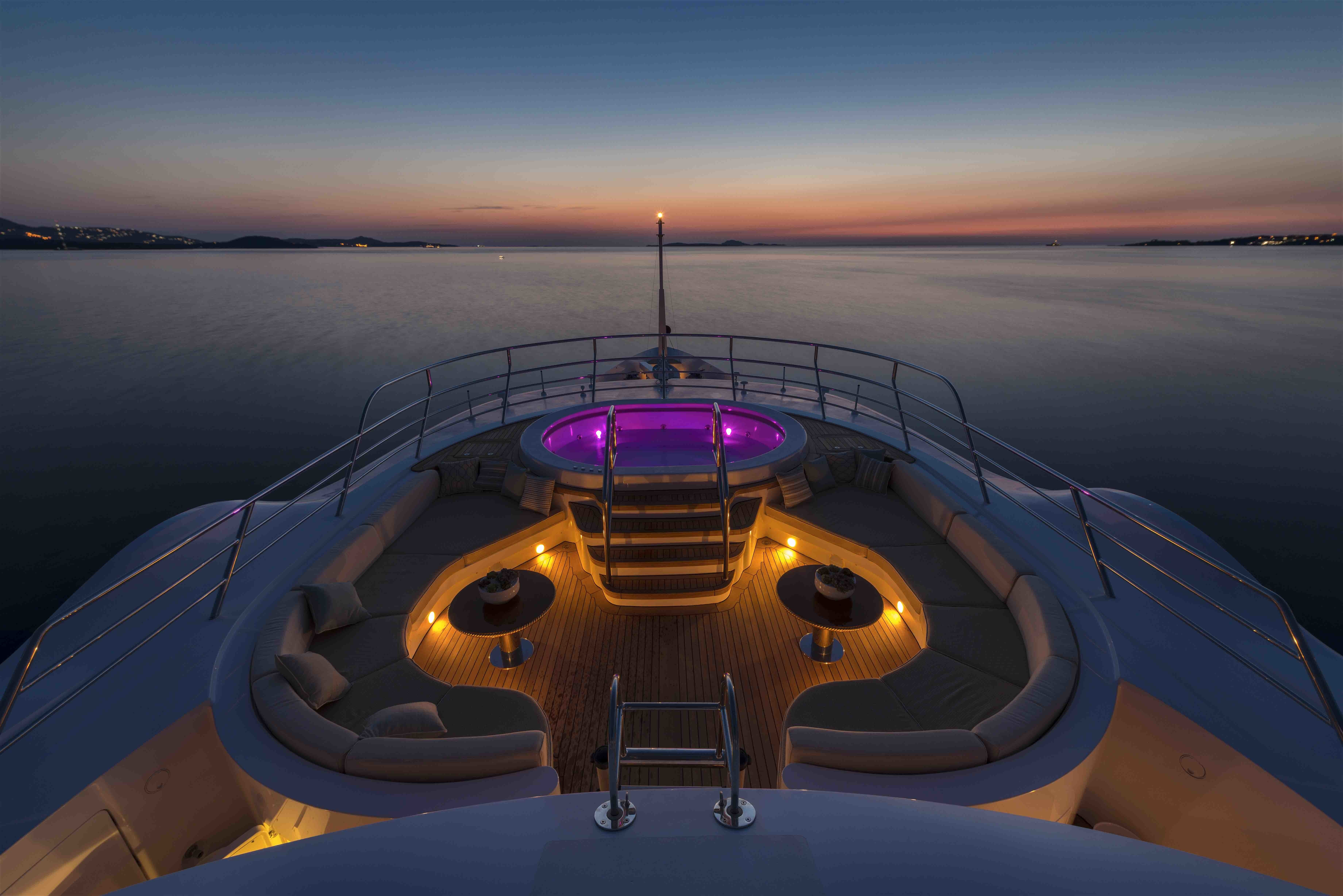 sundeck by night with Jacuzzi lit up