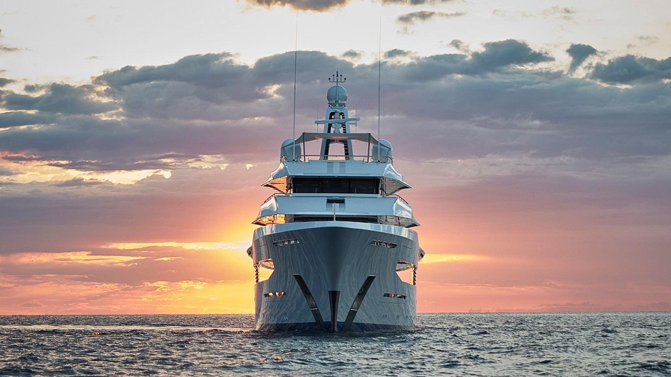 Feadship 70m at sunset looking at the bow