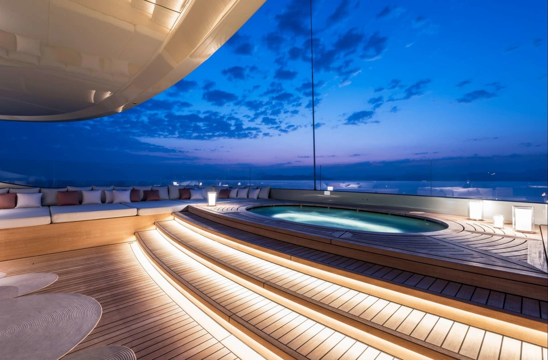 Jacuzzi pool by night on the sun deck