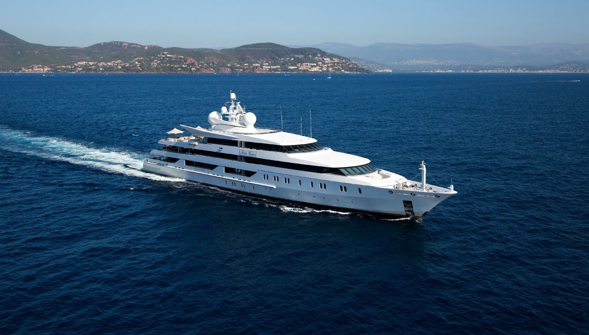 95m Oceanco superyacht running profile aerial view